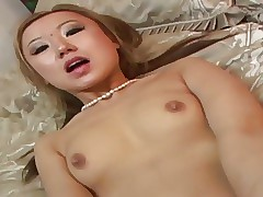 Asian chick gets both holes brim whith a oustandingly dong
